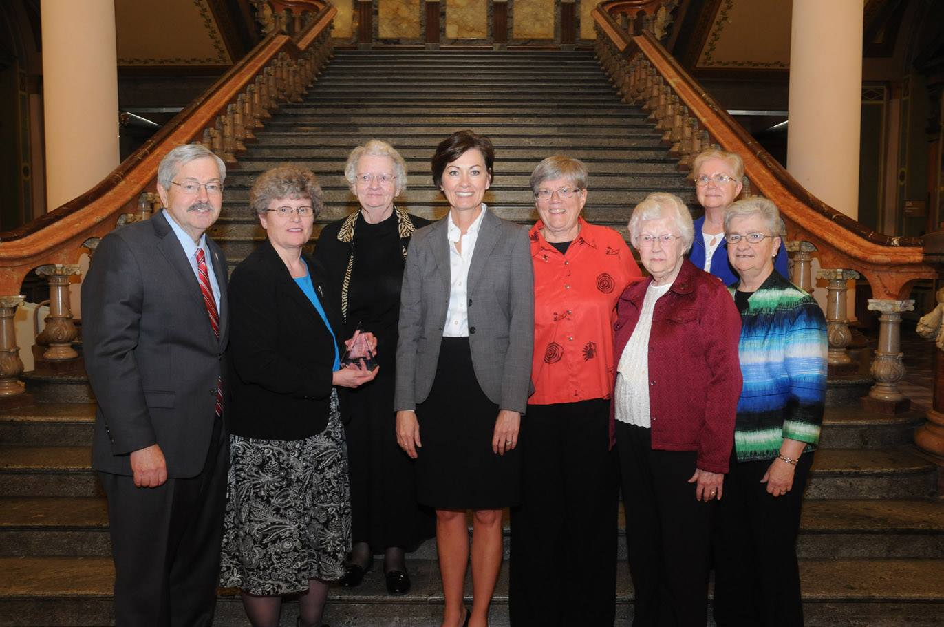 Sisters of Mercy representatives stand with Governor Terry Branstad and Lieutenant Governor Kim Reynolds following the group's induction into the Iowa Volunteer Hall of Fame.