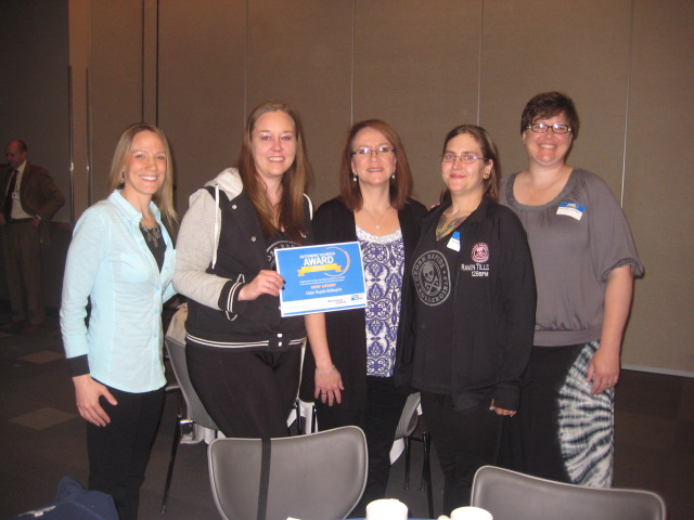 Representatives of the Cedar Rapids Rollergirls (accompanied by CMC staff) attended the United Way of East Central Iowa's breakfast where they were honored as one of three finalists for the Outstanding Volunteer Group award.