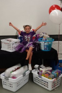 Rizzo poses with the big haul of supplies donated for her 7th birthday.