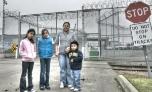 Family outside detention facility